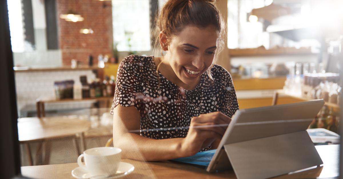 woman in cafe working on ipad
