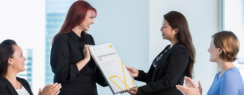 CUA HR giving award to an employee