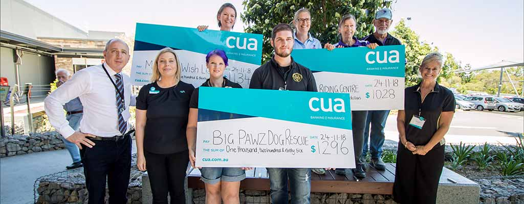 cua donation cheque group photo